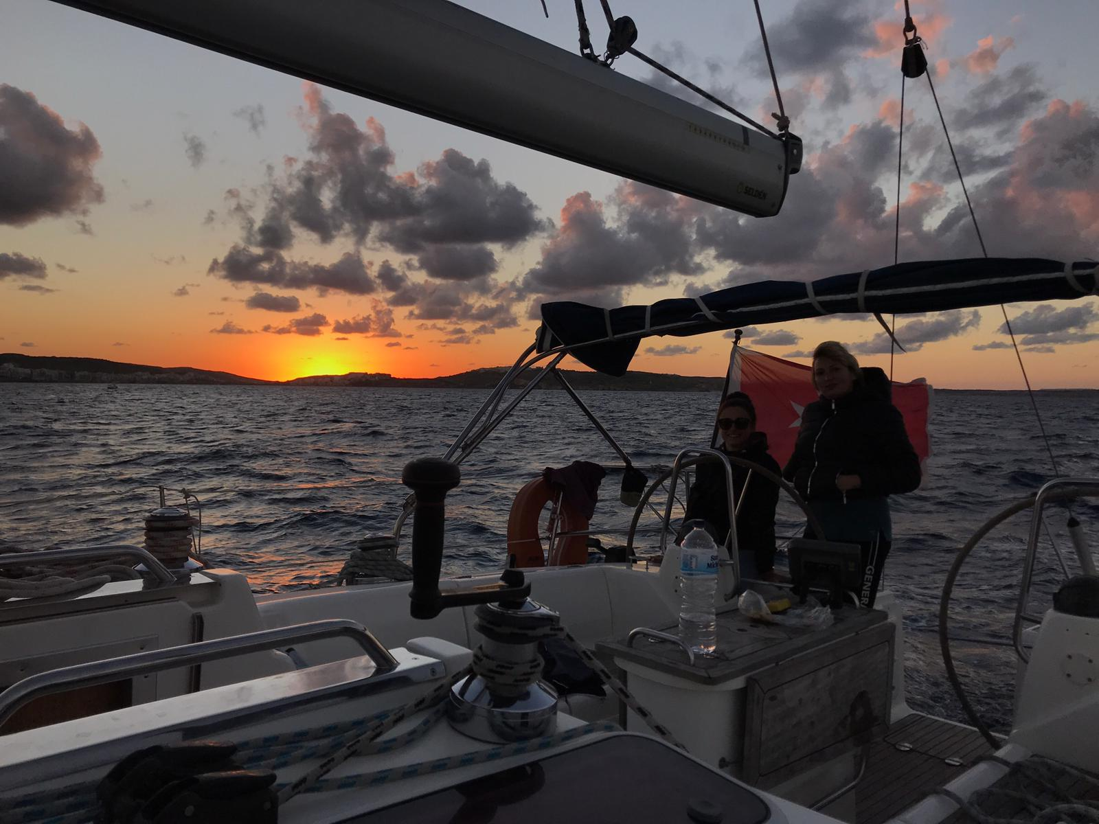 Sunset in malta on a sailing boat