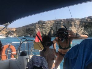 People with masks on the boat