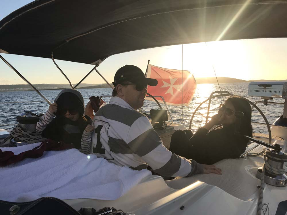 Clients on board watching sunset