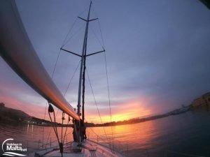 Sail boat on sunset