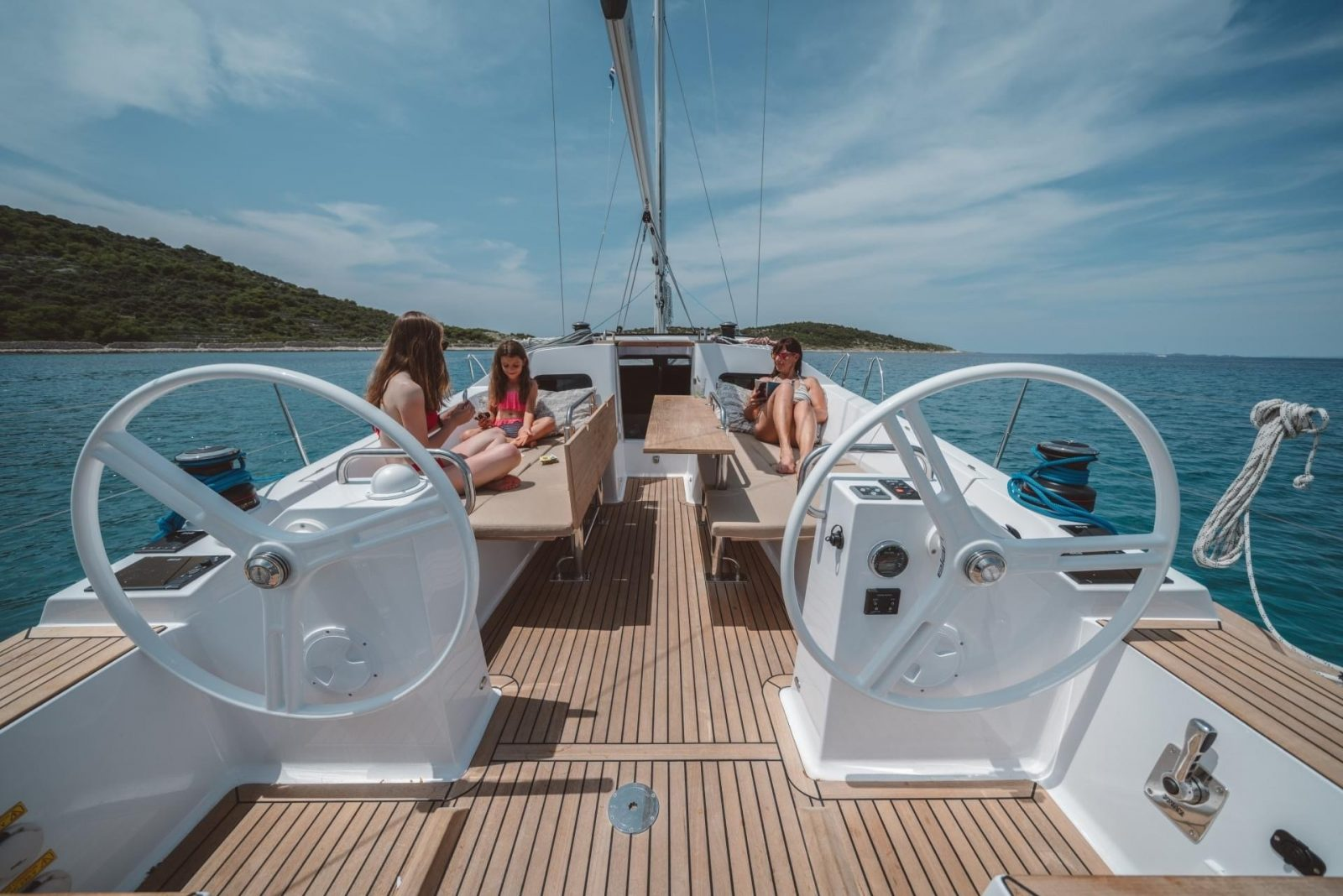 People relaxing in cockpit of a sailing yacht