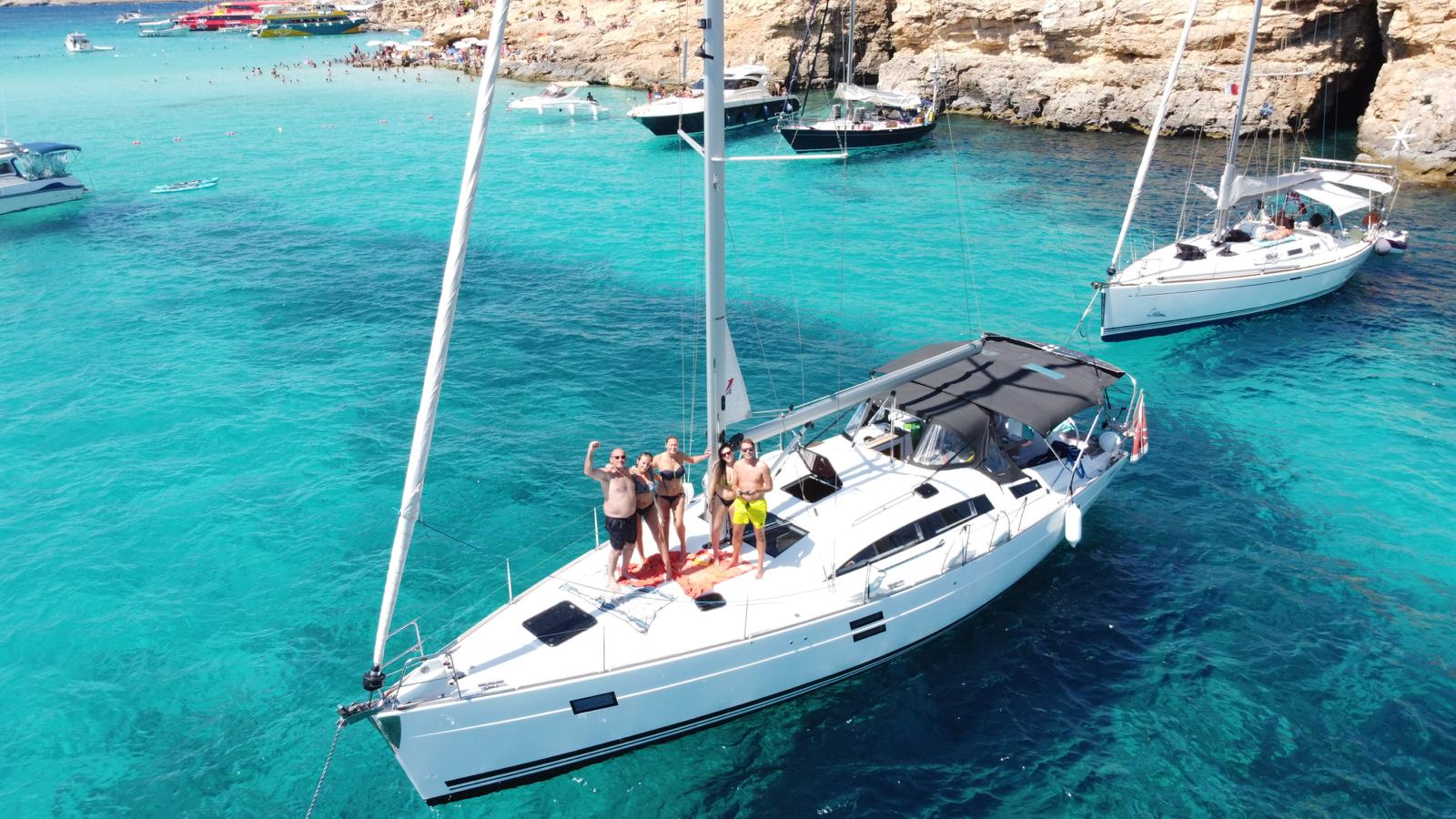 People on a sailing yacht in Blue Lagoon Malta