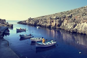 The area of Blue Grotto with boats in the water